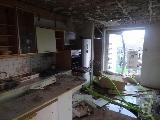 V eksploziji plina več poškodovanih